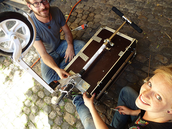 Georg and Felicia work on their flight case scooter