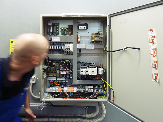 Elevator service guy checking the control box
